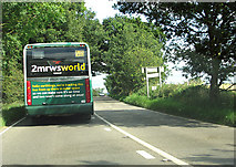 TG0818 : Rural bus on the A1067 (Fakenham Road) past Sparham by Evelyn Simak