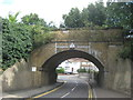 TQ5076 : Railway bridge over Old Manor Way by David Anstiss