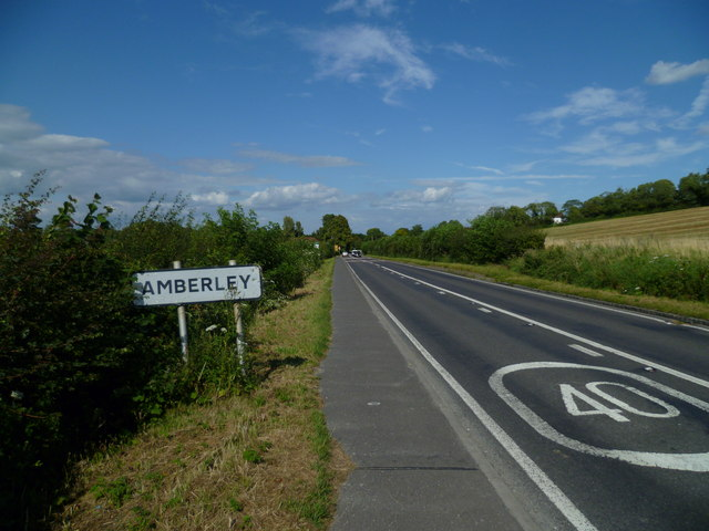 The B2139 enters Amberley from Houghton Bridge