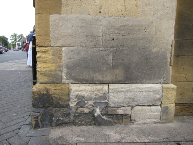 Weathered bench mark on the town hall