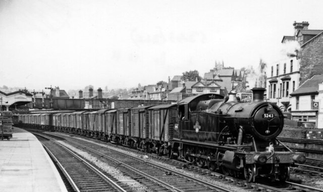 Smart 2-8-0T bringing Up freight through Newport Station