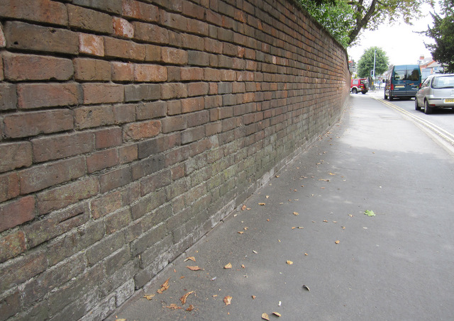 Wall alongside Rother Street and a bench mark - 1
