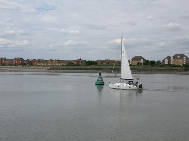 Yacht passing the Black Shelf Buoy off Grays