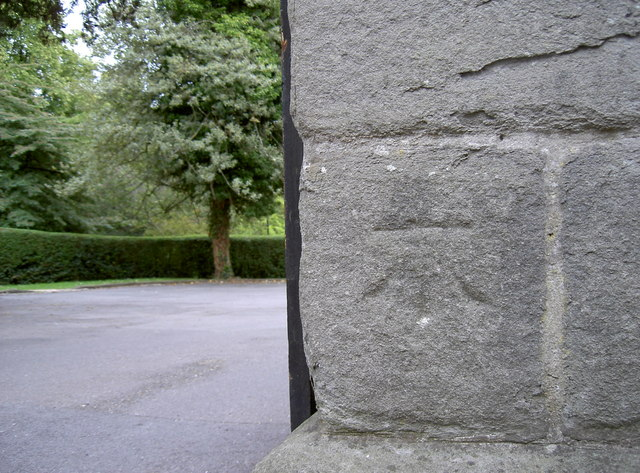 Benchmark at the back of St George's Hall
