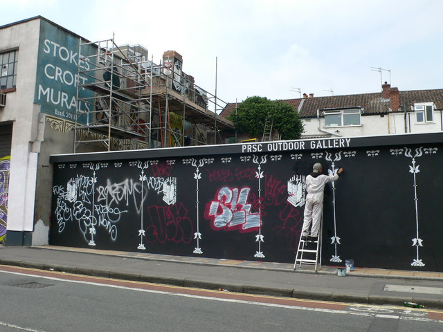 Artist at work at the Peoples Republic of Stokes Croft