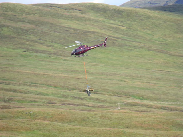 Chopper on eco-run transporting fencing near Meall Gaothach