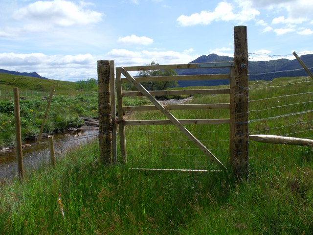 Fencing built by helicopter beside Strone Burn near Loch Katrine