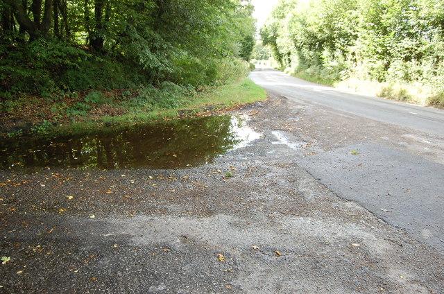 Large Puddle at junction of Mockbeggar Lane and Cranbrook Road