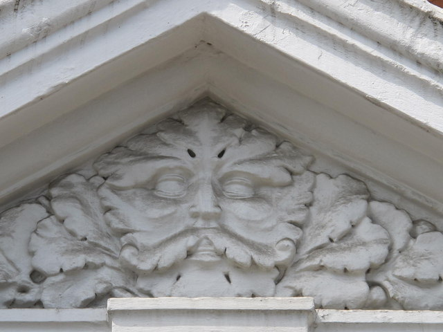 Stone head above doorway in Mazenod Avenue, NW6