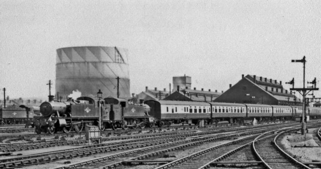 Two 2-6-2Ts bring a London express from Cheltenham into Gloucester Central, past the WR Locomotive Depot