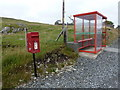 HU2651 : Bridge of Walls: postbox № ZE2 101 and bus shelter by Chris Downer