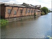 TQ2282 : Grand Union Canal, buildings on Hythe Road by David Hawgood