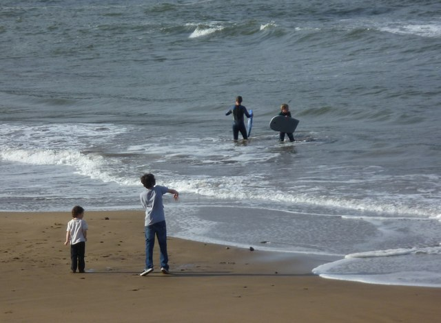 Stone-thrower and surfers at Eyemouth