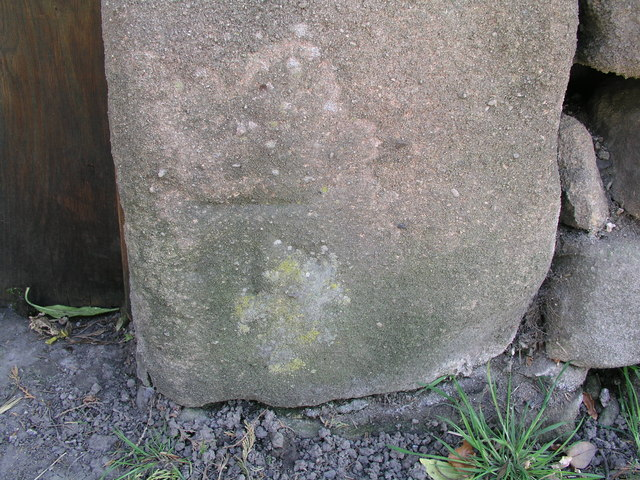 Cut bench mark on old pinfold in Birchover