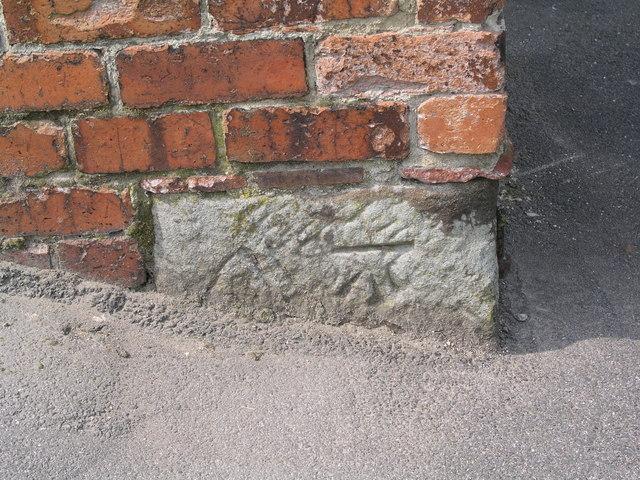 Cut bench mark on rear of premises in Snitterton Road, Matlock