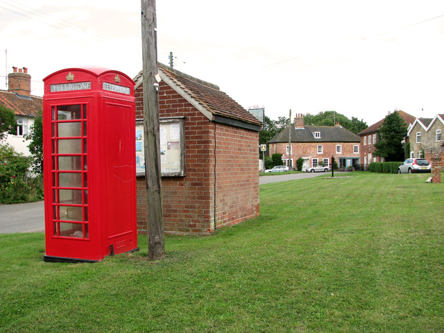 Bus shelter and old telephone box on the green, Middleton