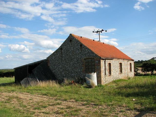 Flint and brick building by Ruberry Hill, Blakeney