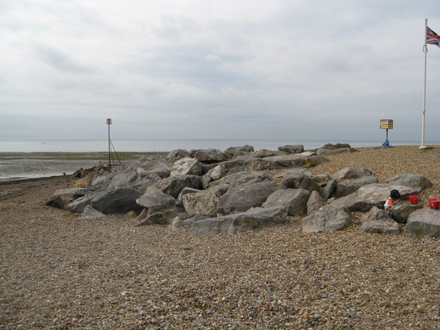 Sea defence rocks by Sea Lane cafe