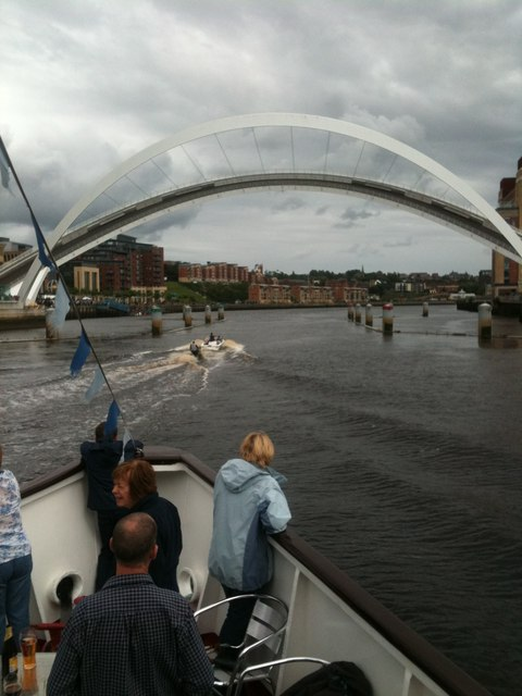 Lifted Millennium Bridge, with small boat and jet skier about to pass underneath
