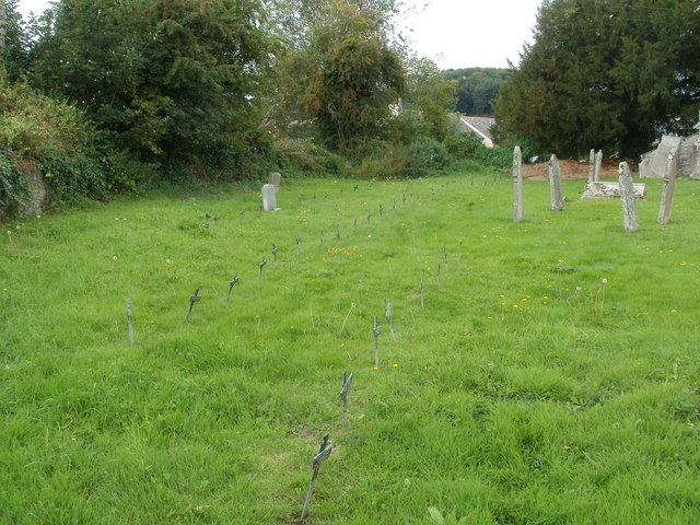 Rows of small black crosses, St Mary's churchyard, Bronllys
