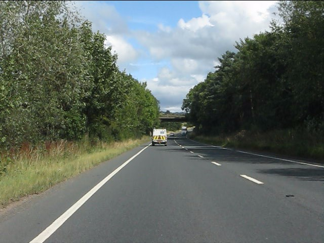 A49 approaching the lane overbridge north of Ludlow