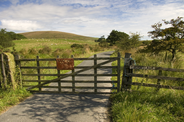 Gate and road to Burnslack