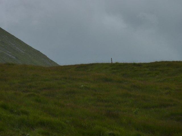 Solitary fence-post, steep slope of Beinn an Dothaidh