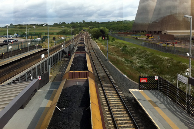A coal train passes through East Midlands Parkway station