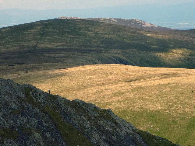 A lone walker ascends Sharp Edge