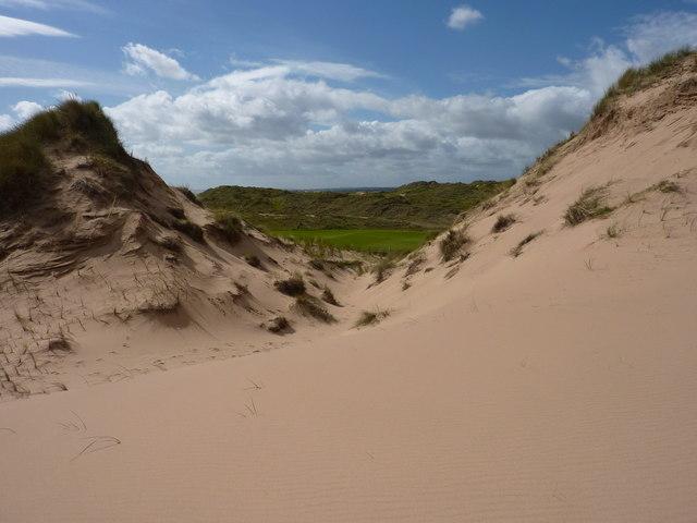 Donald Trump's golf course glimpsed through the sand dunes
