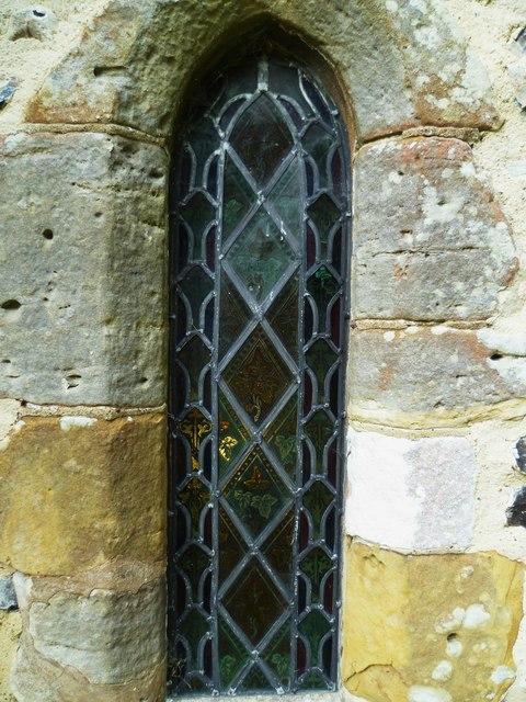 Window with light behind at Edburton church