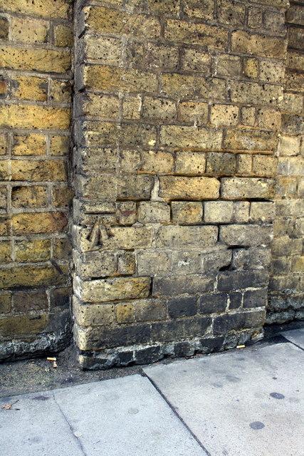 Benchmark on wall pier of Wellington Road outside Lord's Cricket Ground