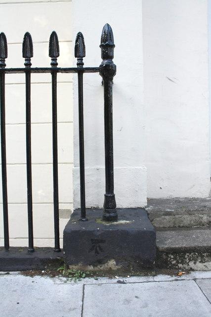 Benchmark on the Taviton Street entrance to #12-14 Endsleigh Gardens