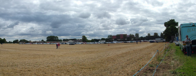 Car parking area for airshow, plus industrial buildings