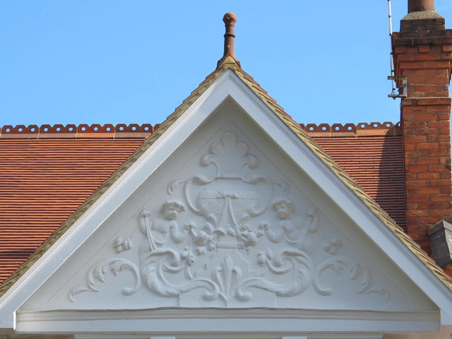 Pretty putti on the gable end of a house in Teignmouth Road, NW2