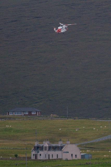 Coastguard helicopter over Baltasound
