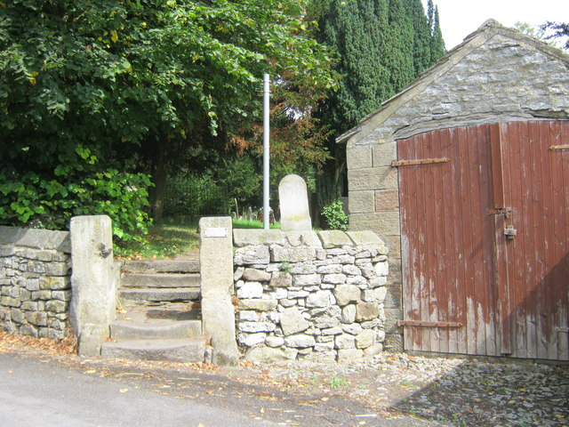 Steps to public footpath through the churchyard in Youlgrave