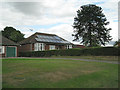 SP2498 : Solar panels and Monkey Puzzle  by Robin Stott