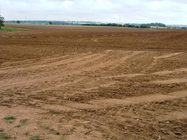 Bare field with a long flat hose