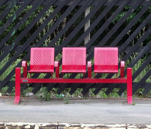Red seating on the Ravensthorpe station platform