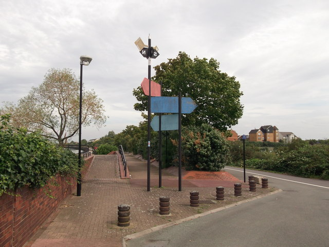 Blue and red signs near Thamesmead Pumping Station