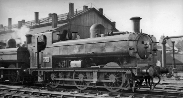 A smart '8750' class 0-6-0PT at Cardiff Cathays Locomotive Depot