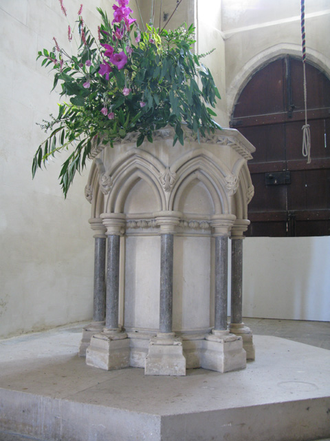 The font in the tower of Holy Cross church