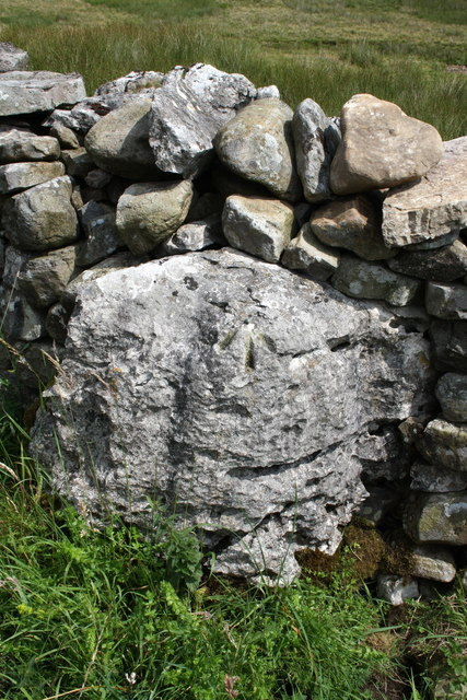 Benchmark on rock in wall at Low Brown Hills Pasture, Kingsdale