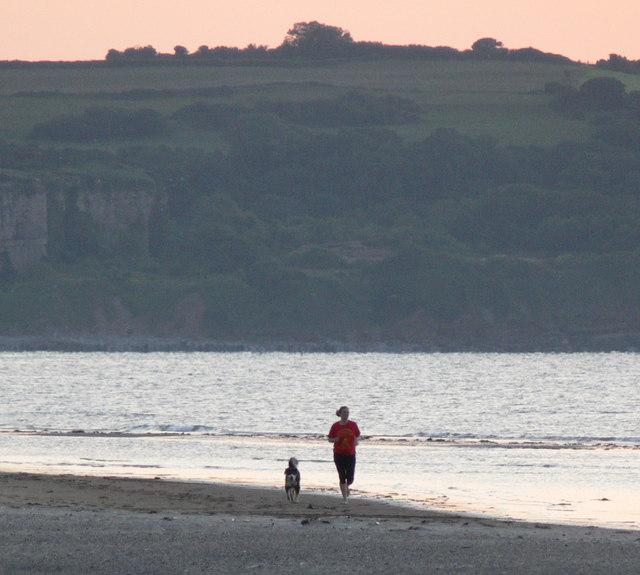 Jogging along Red Wharf Bay