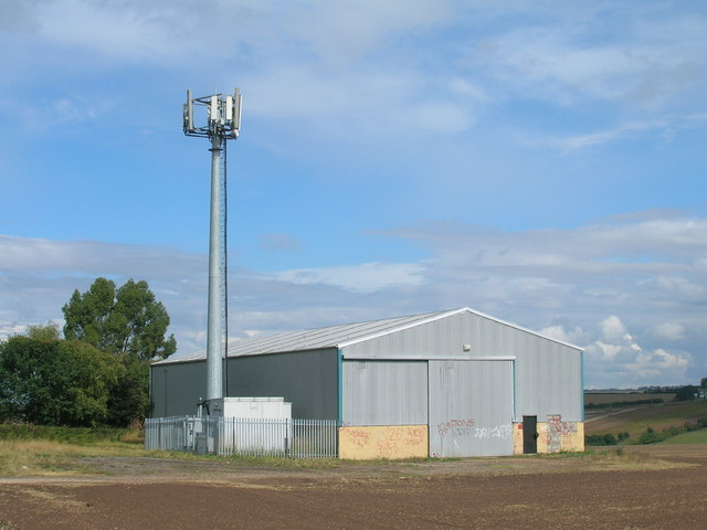 Farm building and communications mast