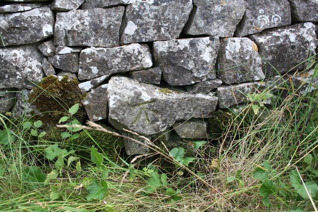 Benchmark on stone in wall near radio station