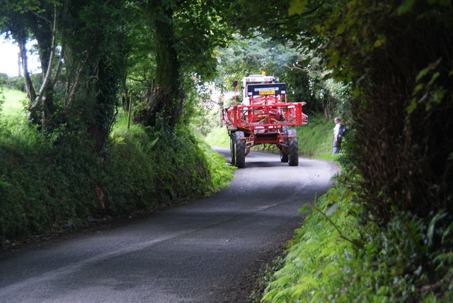 Farm sprayer coming down the lane