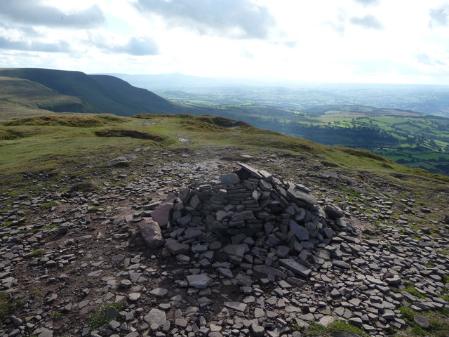Summit cairn on Twmpa with views towards the Brecon Beacons