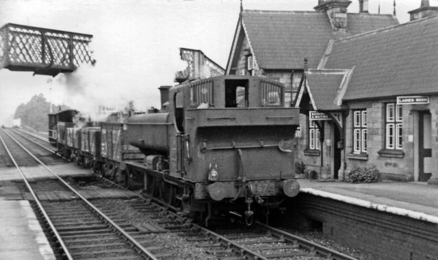 Onibury station remains, with a southbound local  goods train